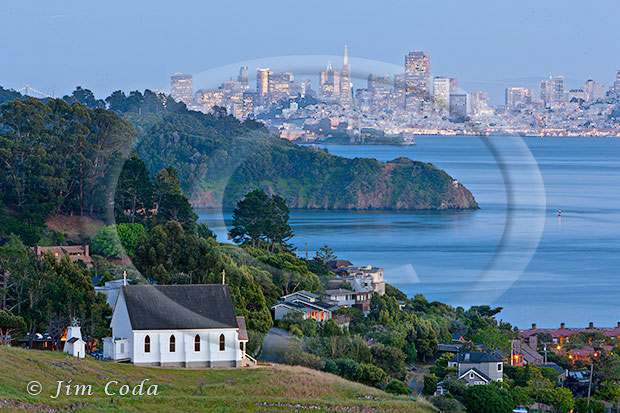 This is a photo of Old Saint Hilary's Church with Angel Island, Alcatraz and San Francisco in the background.