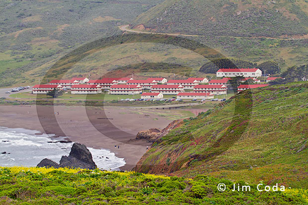 Photo of old Army buildings and Rodeo Beach at what was once Fort Cronkhite.