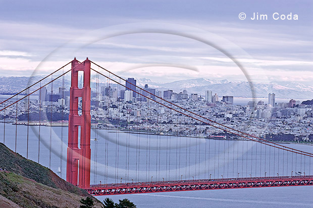 Photo of the Golden Gate Bridge with San Francisco and the East Bay Hills in the background.